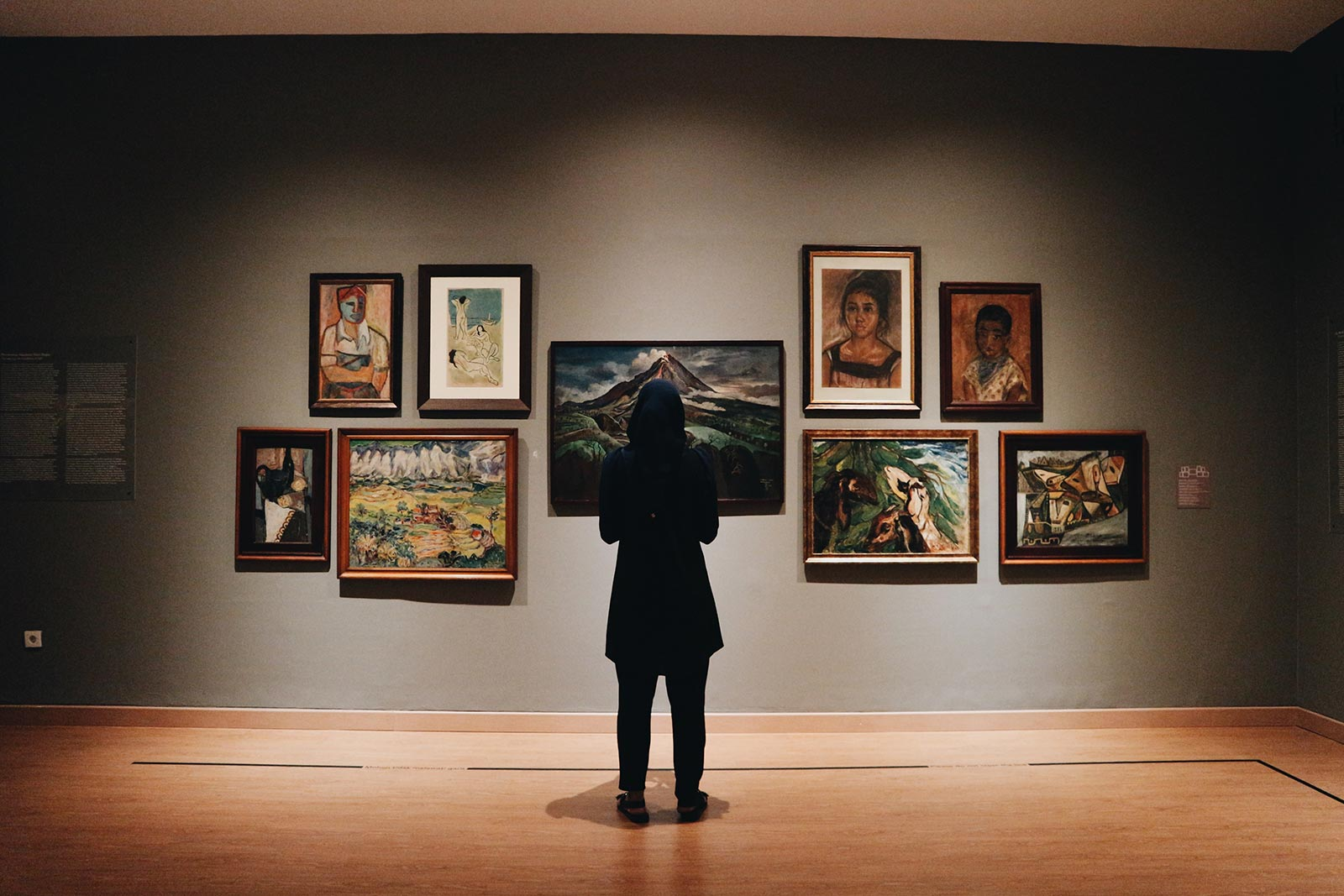 Art gallery with visitor viewing artworks