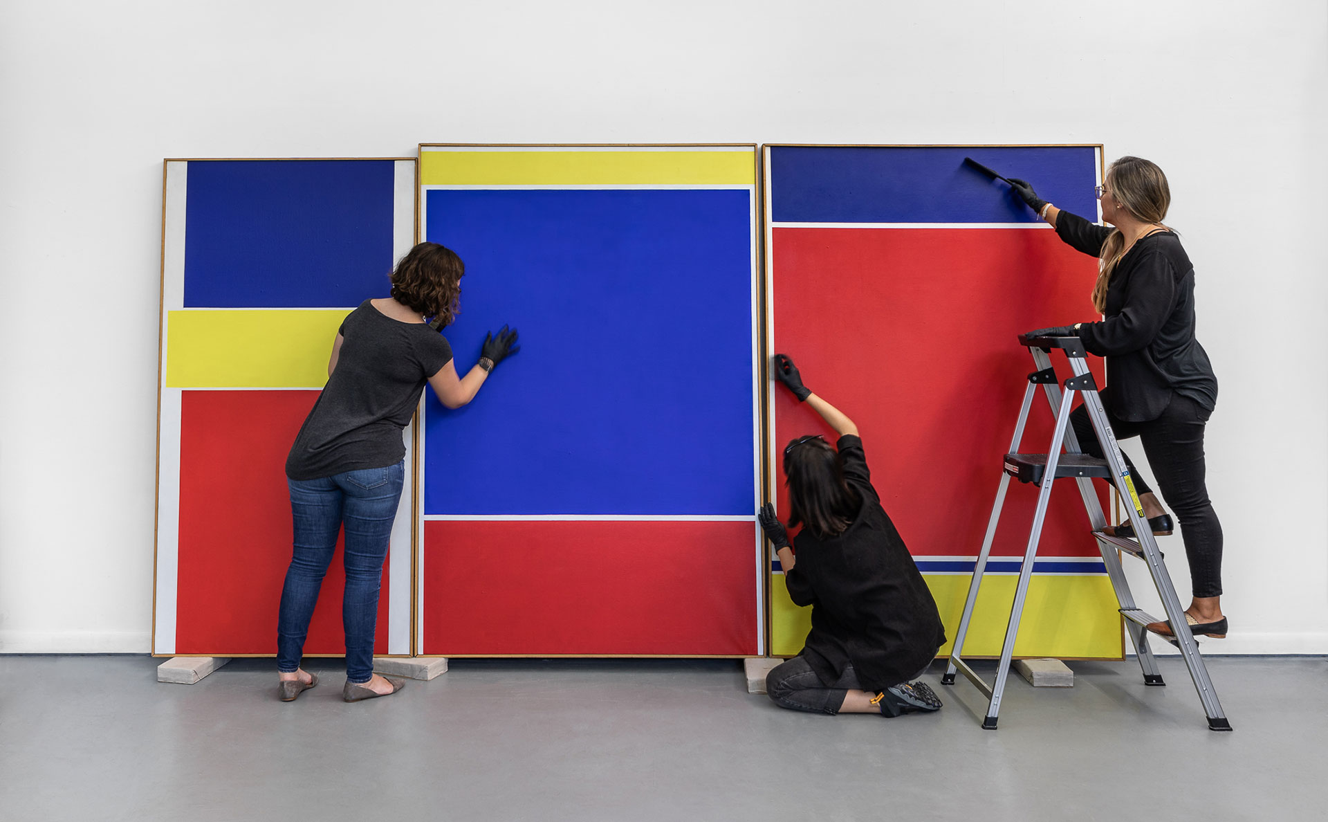 ArtCare conservators examine and perform treatment on a triptych