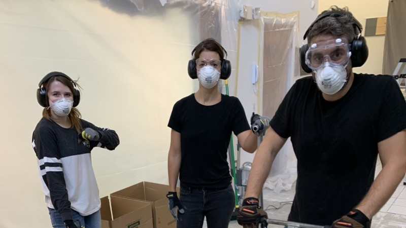 ArtCare staff and intern in personal protective equipment during studio renovation