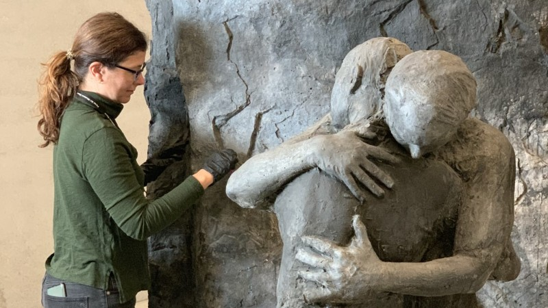 Senior Conservator and Partner, Kelly O'Neill, performs conservation treatment on George Segal's Abraham's 'Farewell to Ishmael'