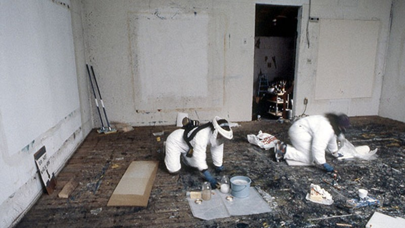 Conservators in personal protective equipment perform conservation treatment in Jackson Pollock's studio