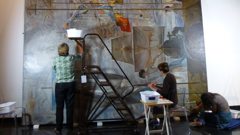 Conservators perform conservation treatment on Salvador Dali's 'The Discovery of America by Christopher Columbus'