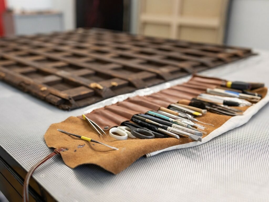 Sleeve of conservation tools next to a panel painting